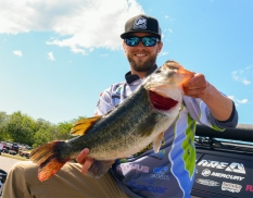 Simms pro Jason Elam with a toad from Day 1. Photo by Joel Shangle.