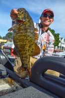 Jordan Lee's rookie year was puncutated by the biggest smallie of his life, this Stugeon Bay pic. Photo by Joel Shangle.