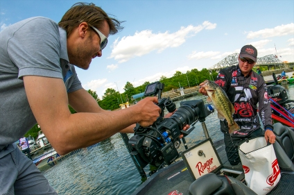 """Cody Meyer bags his fish as the """"Circuit Breaker"""" camera rolls. Photo by Joel Shangle."""
