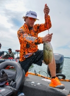 Spiderwire pro Fletcher Shryock hustles a fish into his weigh bag. Photo by Joel Shangle.