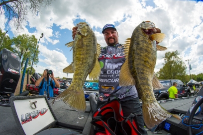 Garmin pro Fred Roumbanis shows off a pair of beautiful Ozarks smallies. Photo by Joel Shangle.