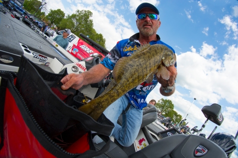 Jeff Kriet bags up a gnarly Bull Shoals smallmouth. Photo by Joel Shangle.