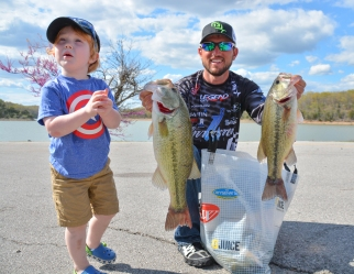 Kei Blaylock is happy to help daddy Stetson show off his fish on Day 2. Photo by Joel Shangle.