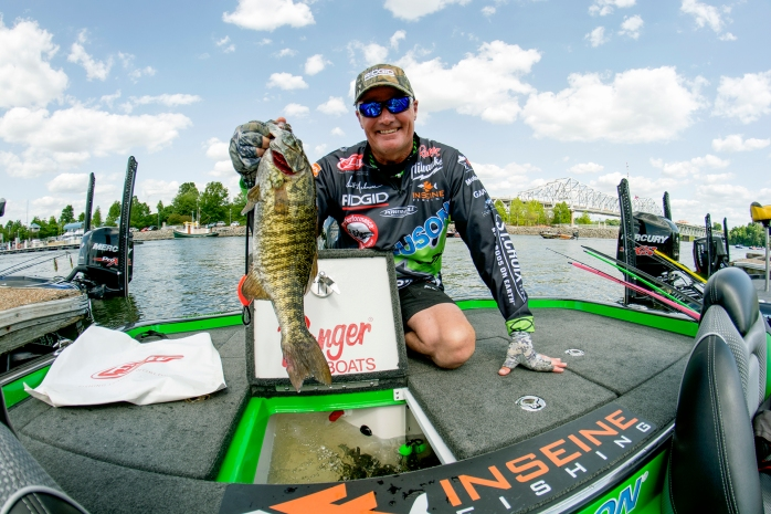 Scott Ashmore with a tiger-stripey smallmouth. Photo by Joel Shangle.