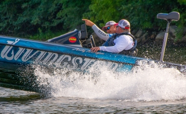 """The fish are thataway,"" Morgan said as he hopped to a new spot on Day 2 at the Forrest Wood Cup. Garmin photo by Joel Shangle."