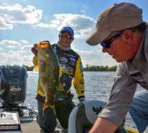 Spiderwire pro Bobby Lane's big Day 1 fish had his marshall's attention. Photo by Joel Shangle.